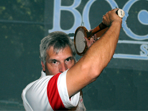 Coach H demonstrates forehand finish with modern equipment.