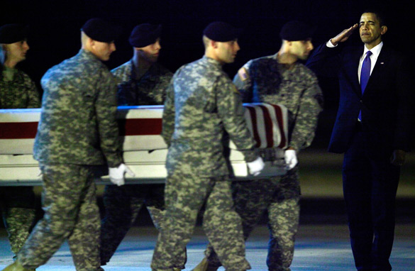 President Barack Obama salutes as a US Army carry team moves the transfer case of US Army Sgt. Dale R. Griffin, during a dignified transfer at Dover Air Force Base on October 29, 2009 in Dover, Delaware. (Getty Images)