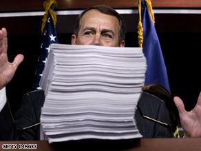 House Minority Leader John Boehner (R-OH) is pictured behind a printout of the 2,000 page health care reform bill during a news conference on Capitol Hill yesterday.