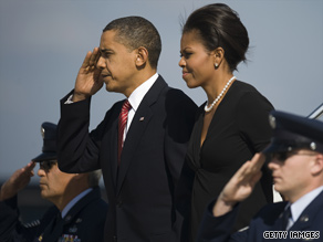 The president saluted as he and the first lady deplaned from Air Force One and headed for Fort Hood on Tuesday.