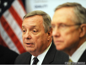 Sen. Durbin, background, said Tuesday that Senate Democrats expect to miss the deadline for the health care bill set by President Obama.