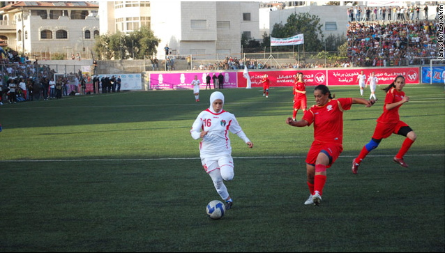 Jordan's captain charges down the wing as they take control of the match. Both teams have Christian and Muslim player, some of whom cover when they play. Photo: James Montague/CNN.
