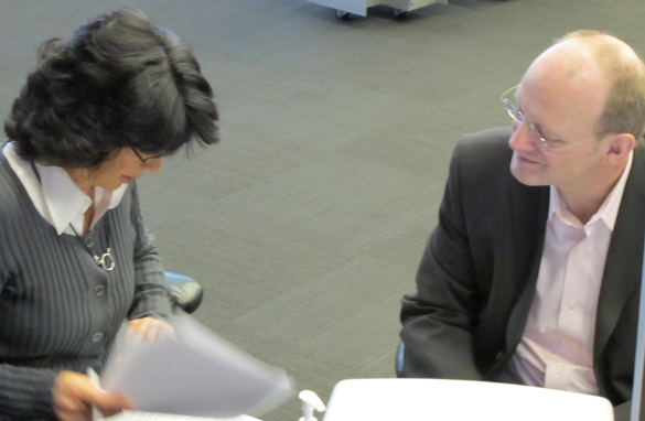 Sr. Writer for Amanpour, Tom Evans, works on scripts   with Christiane