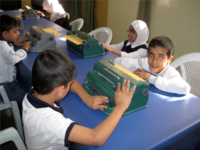 Students use brailers at Baghdad's school for the blind.