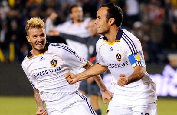 David Beckham celebrates with LA Galaxy team-mate Landon Donovan.