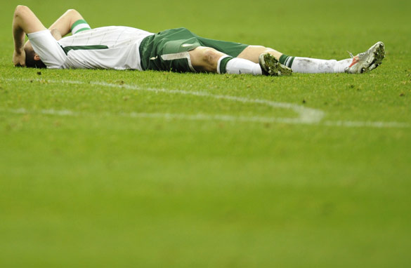 A dejected Irish player reacts to his team's loss to France.