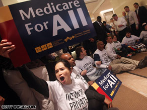 Health care reform supporters participate in a sit-in inside the lobby of a Manhattan building.