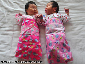 Newborns lie on a hospital bed in Beijing.