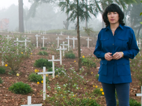 Christiane Amanpour standing in a graveyard in Rwanda for her documentary 'Scream Bloody Murder'