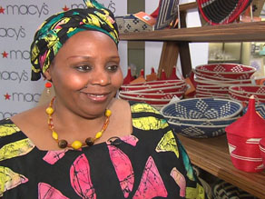 Janet Nkubana, a former refugee from Rwanda, sells baskets for a company she founded that now employs more than three thousand Rwandans.