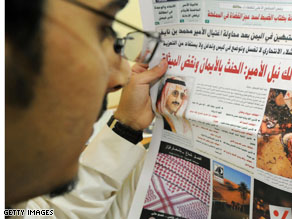 A man reads a newspaper featuring a front-page story on the attack on Saudi deputy interior minister Prince Mohammed bin Nayef.