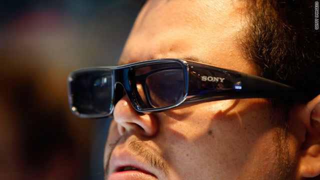 A gamer uses 3-D glasses for a Sony Playstation demo at a video gaming conference in California.
