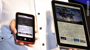 A Sharp engineer displays prototype models of electronic tablets in Tokyo, Japan.