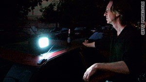 New Yorker Philip Wilentz powers his TV with a car cigarette lighter during 2003's massive blackout.
