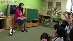 A pre-school teacher introduces a new assistant to the classroom, the robot dog Genibo.