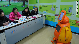Telepresence robots are controlled remotely by a human teacher outside the classroom, whose face appears on the screen.