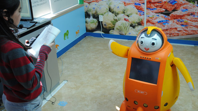A student practices her English pronunciation with a robot as part of South Korea's robot-learning program.