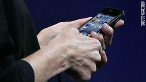 Steve Jobs shows the iPhone 4 at the WWDC conference.