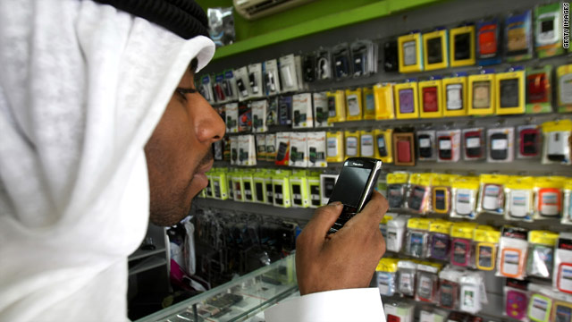 A man in the United Arab Emirates checks out a BlackBerry on Sunday.