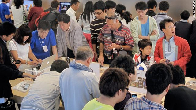China's electronics consumers pack the Apple store in Beijing.