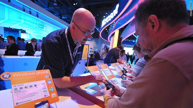 A Microsoft representative shows off the Windows smartphone to attendees at the 2010 CES show in January .