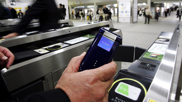 Wireless companies are trying to bring mobile payments to the United States. In Japan, subway riders can pay with phones.