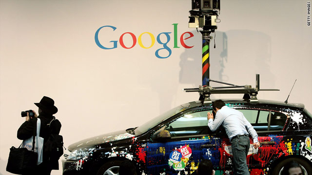 Spectators check out a Google Street View car at an expo in Germany, where info-gathering prompted privacy concerns.