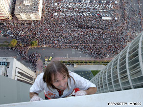 Alain Robert climbs the Abu Dhabi Investment Authority building in Abu Dhabi in 2007.