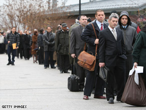 Employment seekers line up to get into a job fair in New York.