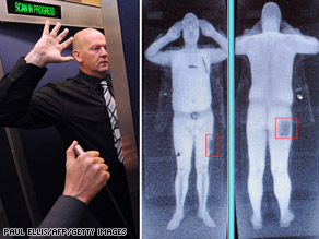 An airport staff member demonstrates a full body scan.