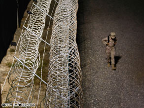The United States is halting for now its plans to continue transferring terror suspects detained at the Guantanamo Bay, Cuba, facility to Yemen.