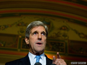 Kerry says Romney is attempting to score political points in 'a footrace to the right against Sarah Palin.'