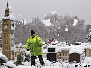A Legoland employee in Berkshire, UK tries to dig out a miniature Houses of Parliament.