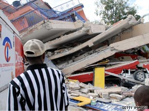 Onlookers examined what remained of a flatten building in Port-au-Prince Wednesday, the day after a large earthquake struck near Haiti's capital city.