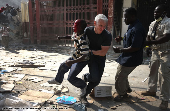 haiti.ac.boy.2 Anderson in the midst of looting chaos
