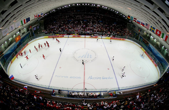 Can the Canada Olympic ice hockey team, seen here playing Russia (in red) in 2006, triumph as hosts and recruit a new fan in the process?.