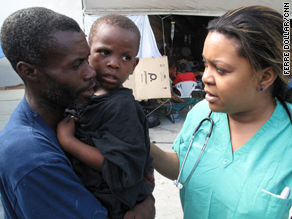 Nurse Fabienne Goutier, right, tends to Jean Wesley Marc, 4, and his father, Manes Marc, in Port-au-Prince, Haiti.
