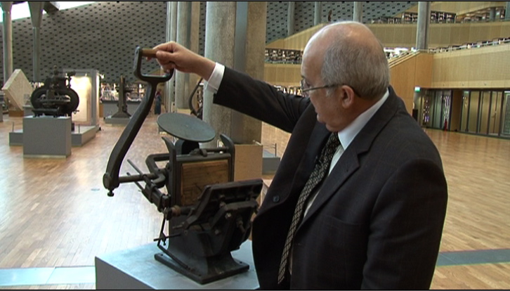 Head of the library Ismail Serageldin shows off one of the BA&#039;s treasures - a hand-operated printer from 1825.