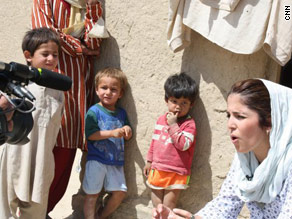 At an internally displaced person camp in September 2009 (with headscarf, as I was also in the photo, at top, later last year with school girls in Kabul.)