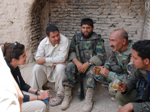 With an Afghan general in Khan Neshin, Helmand province in July 2009 (no headscarf)