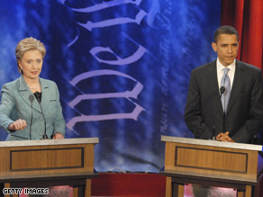 (FILE PHOTO) Clinton and Obama during the April 2008 debate in Philadelphia.