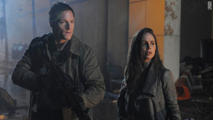Tahmoh Penikett and Eliza Dushku in the series finale of 'Dollhouse'
