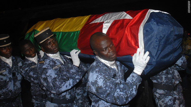 A coffin containing one of the three killed in the terrorist attack returns to Togo.