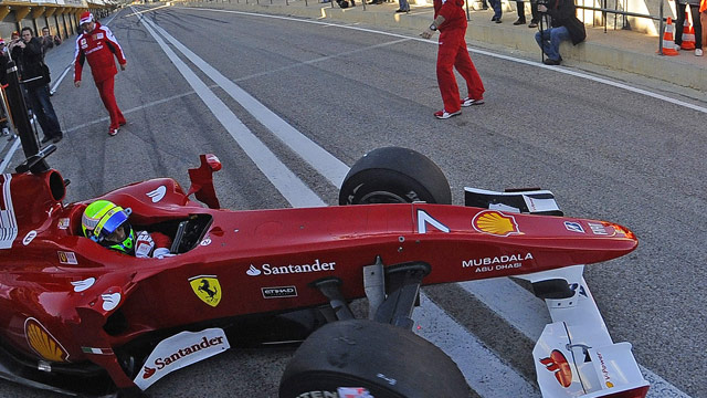 Massa enjoys testing the new Ferrari F1 car at Valencia.