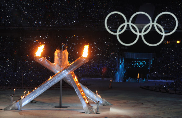 The Olympic flame is lit at the conclusion of the opening ceremony for the Winter Games in Vancouver .
