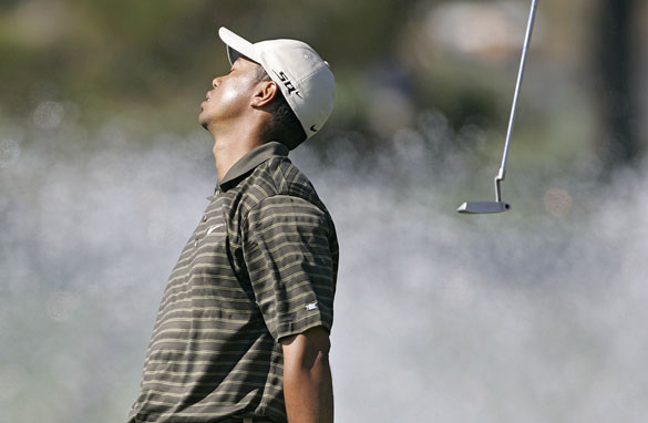 Tiger Woods tosses his putter in frustration having missed a putt at La Costa Resort in California, 2006.