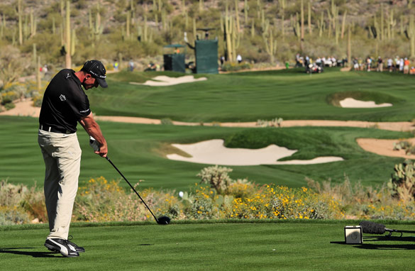 Geoff Ogilvy plays his tee shot at the 16th hole in the final round of his victorious Dove Mountain campaign in March 2009.
