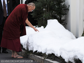 The Dalai Lama draws in the snow with his finger outside the White House after meeting with Pres. Obama earlier today. The meeting drew angry protests from China.