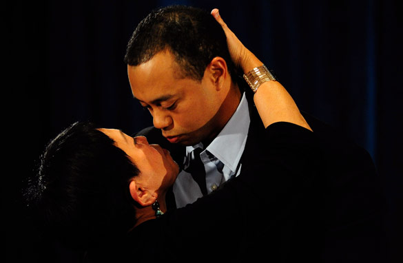 Tiger Woods hugs his mother having given his scripted speech (Getty Images).