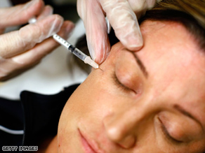 A woman receives a Botox injection.